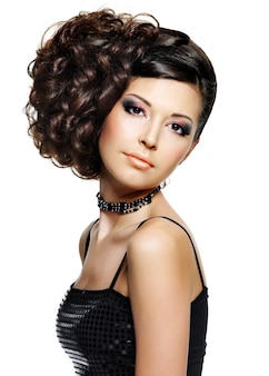 Beautiful young woman with fashion hairstyle and glamour makeup - on white space