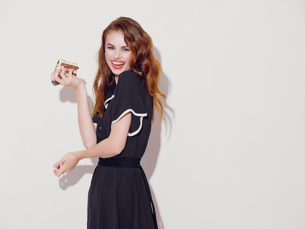 Beautiful young woman with food in her hands, a woman eating, no diets