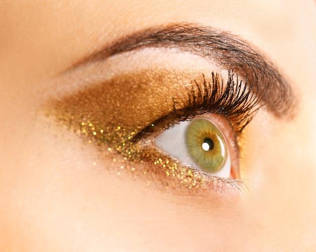 Beautiful young woman with holiday makeup, closeup