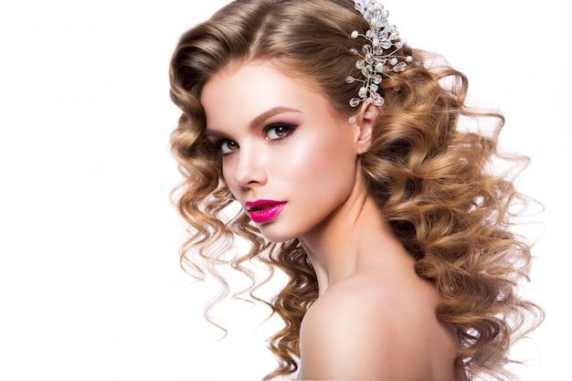 Beautiful young woman with long hair posing