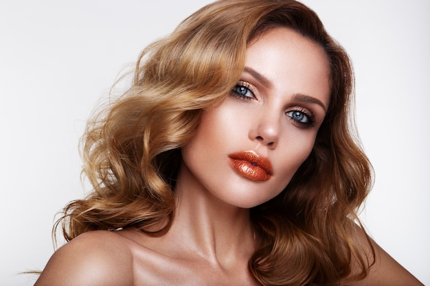 Beautiful young woman with orange lips. blue eyes