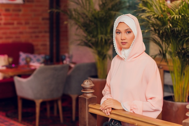 Beautiful young woman with a pink hijab.