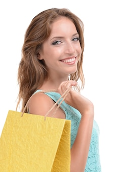 Beautiful young woman with shopping bags on white
