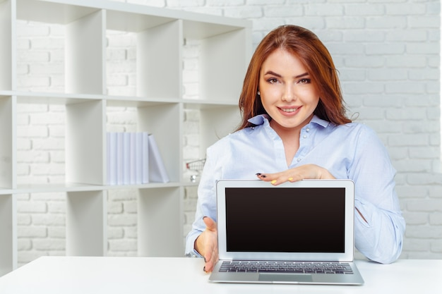 Beautiful young woman working on computer