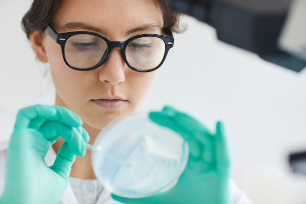 Beautiful young woman working in laboratory