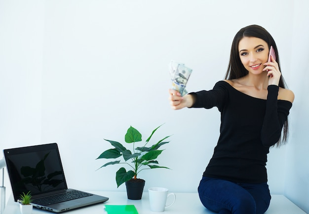 Beautiful young woman works on the computer.