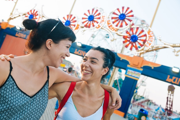 Beautiful young women in coney island at sunset