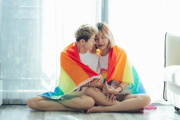 Beautiful young women lgbt lesbian holding each other