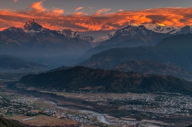 Beautifull cloudy sunrise in the mountains with snow ridge fron himalaya view point, pokhara nepal