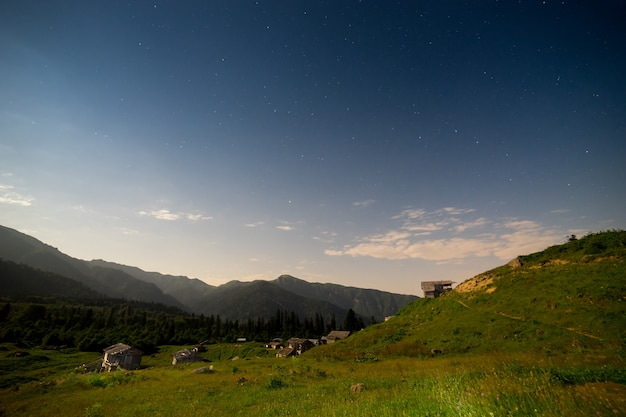 Beautifull scenery of a night summer starry sky wooden house, gorgit highland artvin, turkey