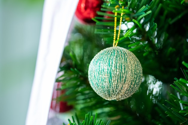 Beautifully christmas decorated bokeh background home interior with a christmas tree