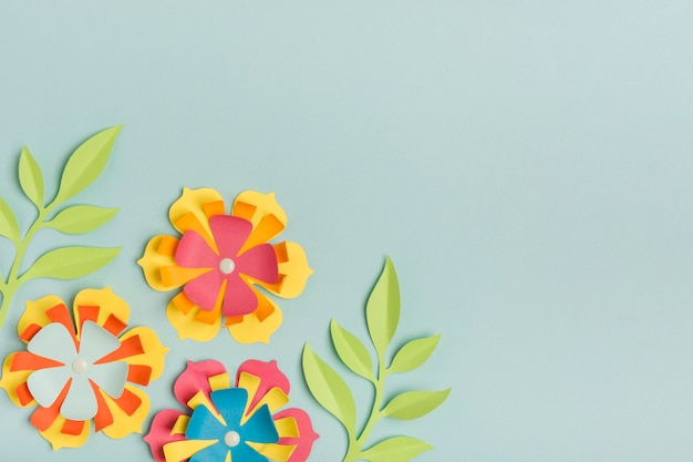 Beautifully colored paper spring flowers with copy space