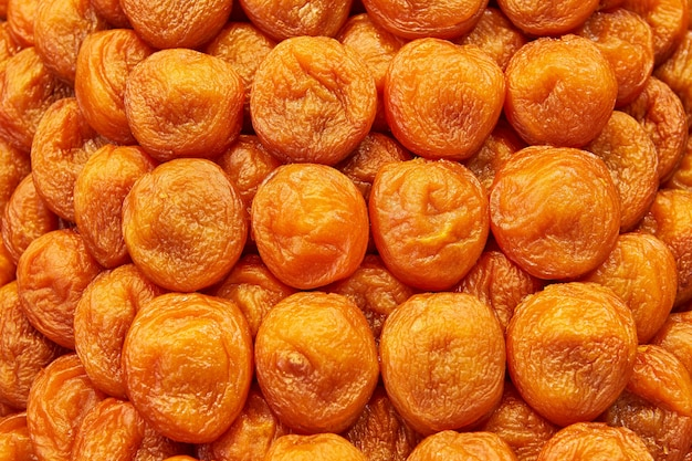 Beautifully decomposed dried apricot fruits forming a food background.
