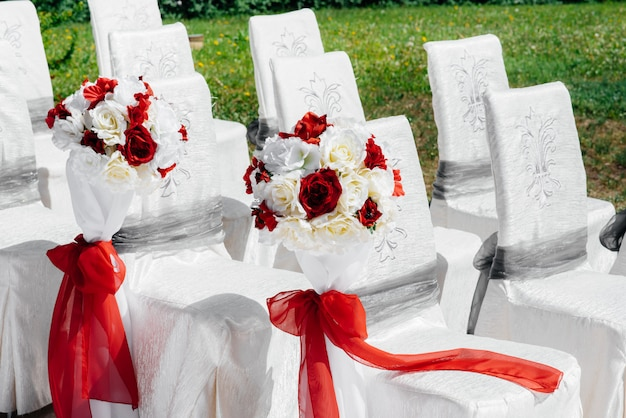Beautifully decorated and arranged chairs for a festive banquet. decor, wedding.