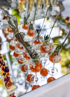 Beautifully decorated catering banquet table. different food snacks and appetizers on corporate party event or wedding celebration.