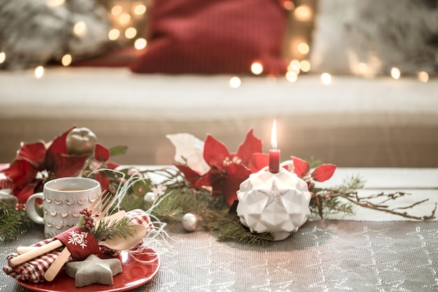 Beautifully decorated christmas table in the living room.