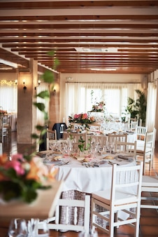 Beautifully decorated tables for guests with decorations in a restaurant.