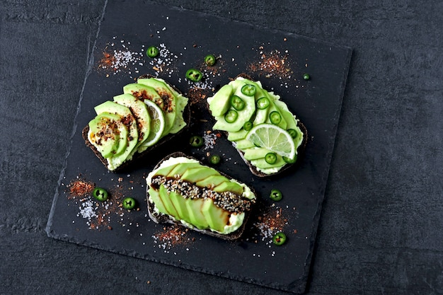 Beautifully plated avocado toast with delicious-looking toppings.
