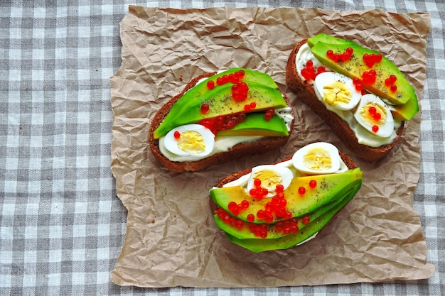 Beautifully served avocado toasts with delicious topping. flat lay.