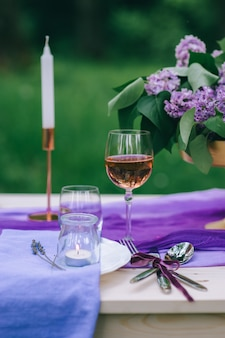 Beautifully served table outdoor with flowers and decor