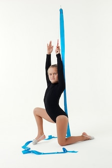 Beauty acrobat practices gymnastic yoga isolated on a white background.