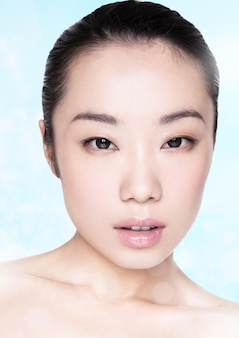 Beauty asian fashion model girl healthy cosmetic makeup portrait on blue background