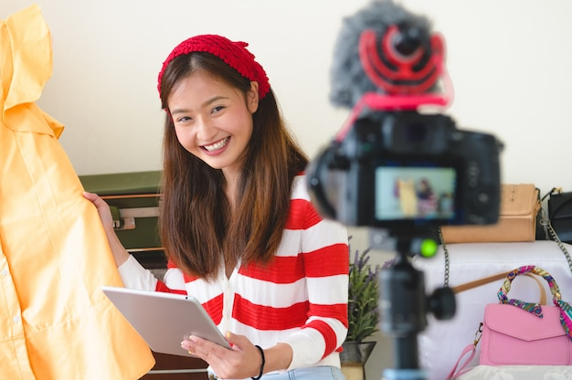 Beauty asian vlogger blogger interview with professional dslr digital camera film video