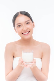 Beauty asian woman cute girl feel happy drinking milk for good health in the morning on white background - lifestyle beauty woman concept