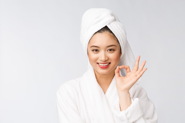 Beauty asian woman ok gesture for good facial product isolated beauty and fashion concept