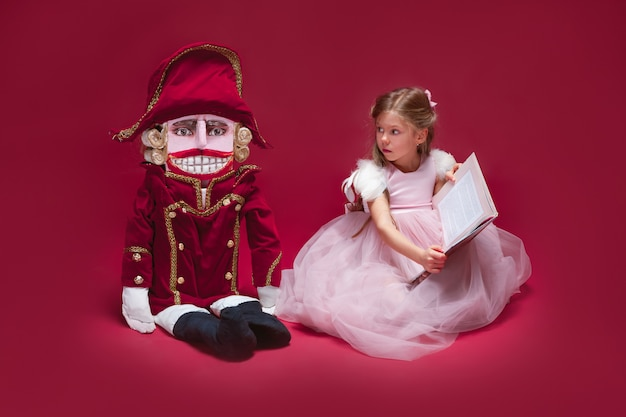 Beauty ballerina sitting with nutcracker