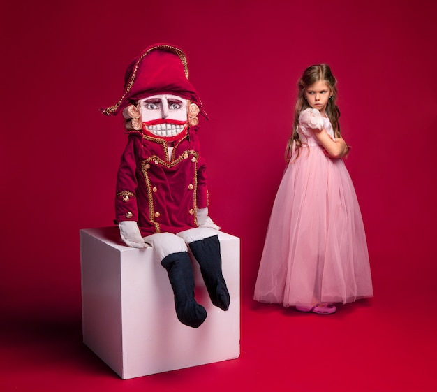 Beauty ballerina standing with nutcracker