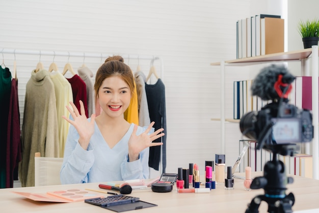 Beauty blogger present beauty cosmetics sitting in front camera for recording video