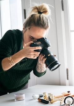 Beauty blogger taking photo of cosmetics