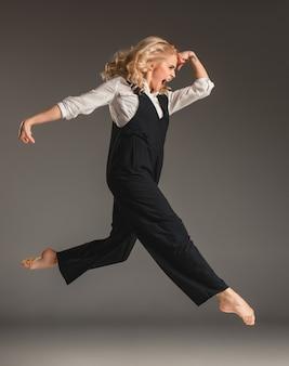 Beauty blond woman in ballet jump