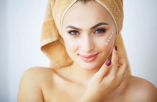 Beauty and care, portrait of a girl with a brown towel on the head,