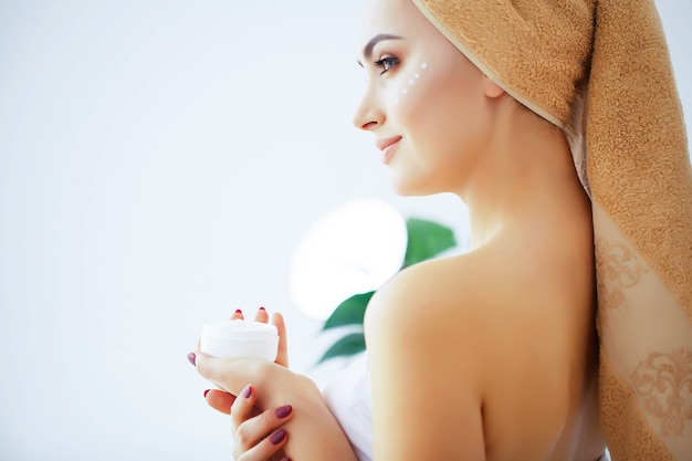 Beauty and care, woman with pure skin and towel on the head pour