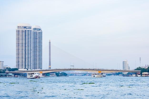The beauty of the chao phraya river and boat at pinklao bridge