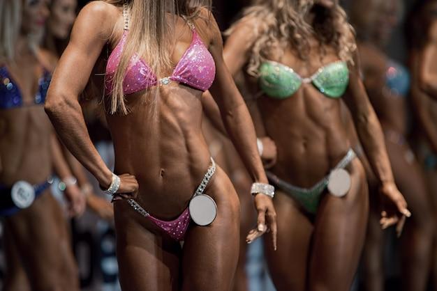 Beauty contest. fitness bikini contest. sexual woman's body.