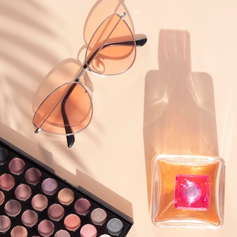 Beauty cosmetics pack with perfume and sunglasses