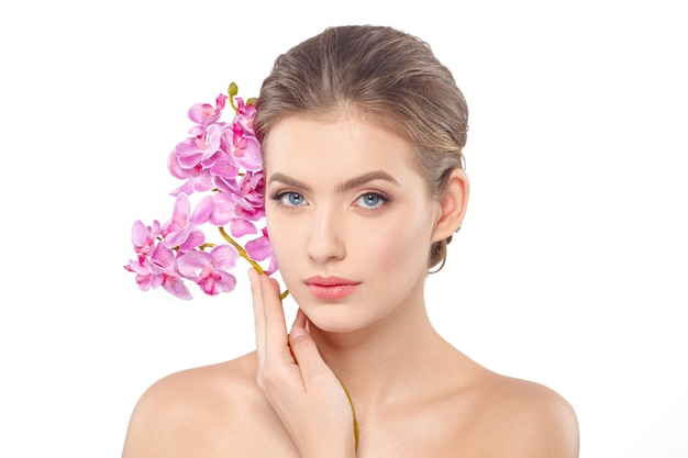 Beauty face of the young beautiful woman with flower