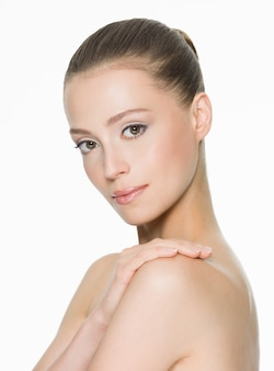 Beauty face of an young woman with clean skin posing isolated on white