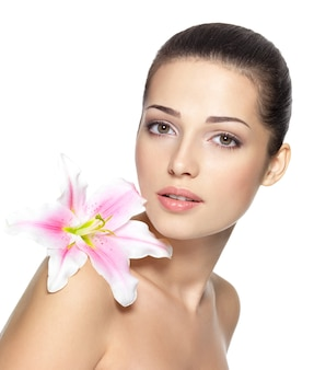 Beauty face of young woman with flower.