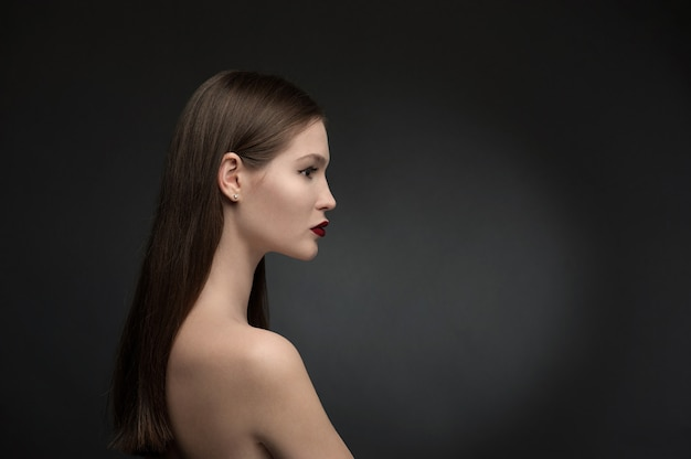 Beauty and fashion model on the black background