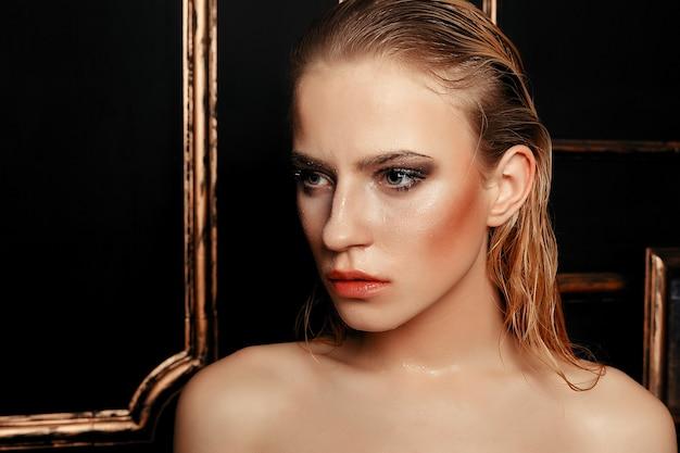 Beauty fashion model on black gold background