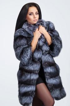Beauty fashion model girl in blue mink fur coat