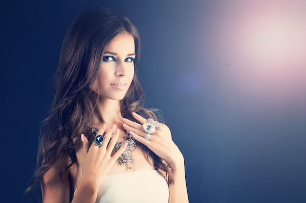 Beauty fashion portrait of pretty woman. make-up. jewelry ring and necklace