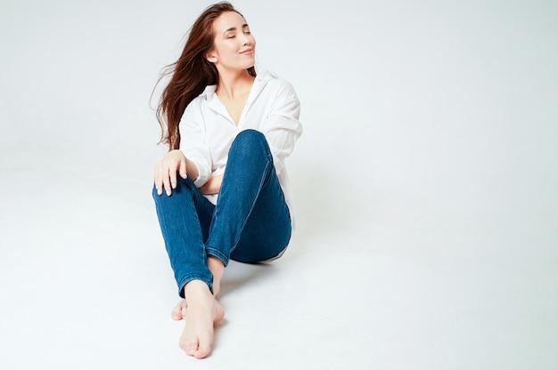 Beauty fashion portrait of smiling sensual asian young woman