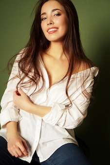 Beauty fashion portrait of smiling sexy sensual asian young woman with dark long hair in white shirt