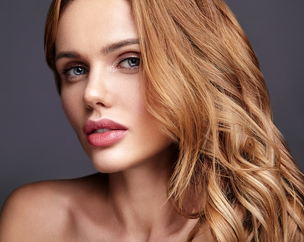 Beauty fashion portrait of young blond woman model with natural makeup and perfect skin posing