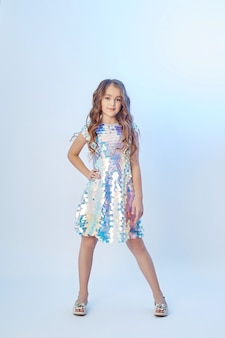 Beauty fashion portrait of a young girl in a dress
